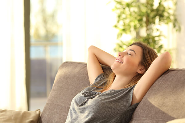 Woman enjoying air in home